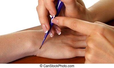 Mehendi drawing process on hand, white