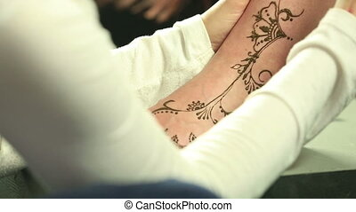 Mehndi. View of beautiful pattern on model's leg