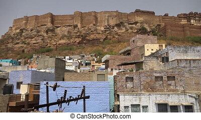 Mehrangarh Fort on a mountain behind Jodhpur - Panning low...