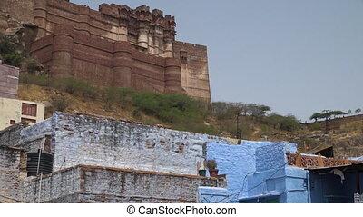 Mehrangarh Fort towering above Jodhpur - Wide shot of...