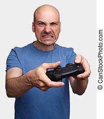 meio envelheceu, homem, tocando, vídeo, games.