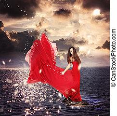 meisje, in, rode jurk, staand, op, oceaan, rotsen