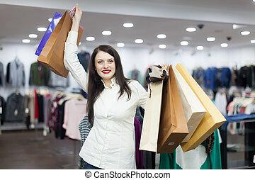 meisje, met, het winkelen zakken, op, de opslag van de kleding