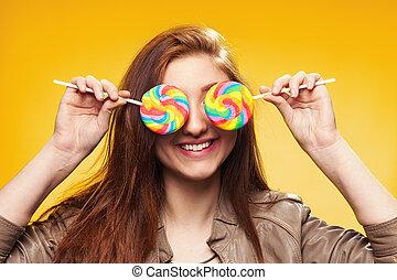 meisje, vrolijke , jonge, gele, lollipop