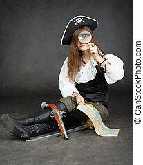 meisje, zeerover, en, kaart, met, een, vergrootglas, zittende , op, een, zwarte achtergrond