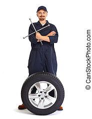 mekaniker vogn, hos, en, dæk, wrench.