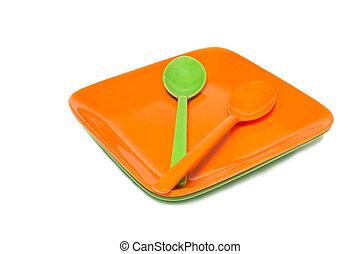 Melamine orange and green dish spoon set on white background