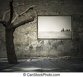 Beautiful melancholic background representing a tree inside a decadent room with leaves on floor, an window with landscape