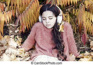 Melancholic melody. Listening song. Enjoy music outdoors fall warm day. Audio file. Boring podcast. Autumn playlist concept. Girl relaxing near autumn tree with headphones. Music for autumn cozy mood
