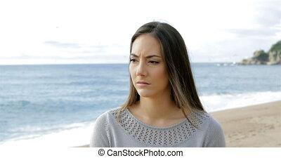 Melancholic woman walking on the beach - Melancholic woman...