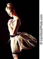 melancholy - Beautiful ballet dancer posing at studio.