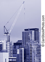 Tower crane in new building construction site