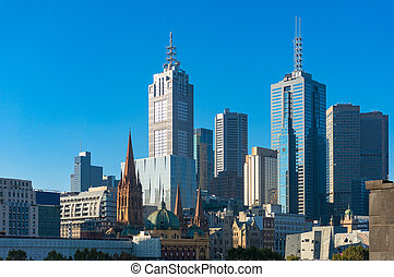 Melbourne CBD view wit Flinders station, St Paul's Cathedral and skyscrapers