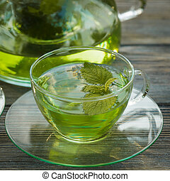 Melissa tea - Herbal tea with melissa in a glass cup and ...