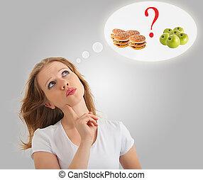 mellan, bakgrund, matar, märken, attraktiv, sjuklig, begreppsmässig, kvinna, hamburgare, äpple, val, nymodig, ung, hälsosam