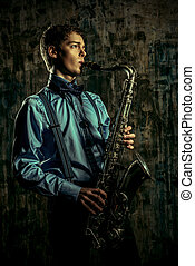 melody of jazz - Young expressive musician playing the ...