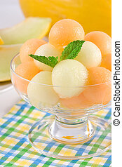 Melon and cantaloup balls with fresn mint leaf