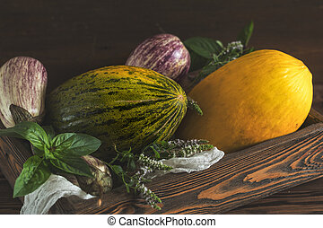 Melon, basil, mint, purple graffiti eggplants, onion and...