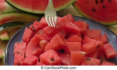 Melon pieces in blue bowl - Fresh water melon pieces in blue...