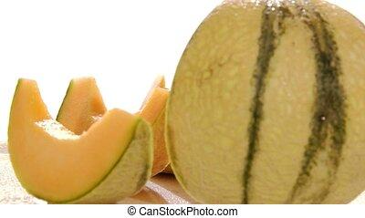 melon rotating over white background