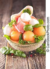 melon salad with mozzarella and prosciutto ham