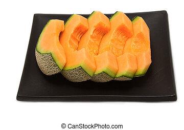 melon slices on black background