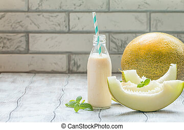 melon smoothie in a glass bottle
