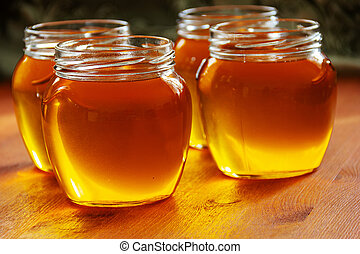 melted butter in glass jars