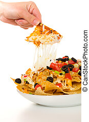 Melted cheese nachos on white - Nachos with vegetable on the...