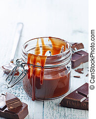 Melted chocolate in a glass jar