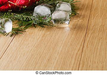 meltel ice on oak table background