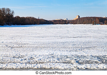 melting ice on frozen lake