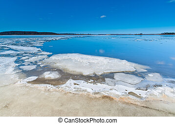 Melting ice on the lake during the ice drift.