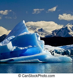 melting iceberg from dyeing glacier drifting away on...
