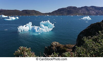 Melting Iceberg outside the town of Narsaq in South...