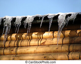 icicles on a wooden wall