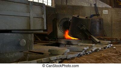 Melting metal being heated in workshop 4k - Melting metal ...