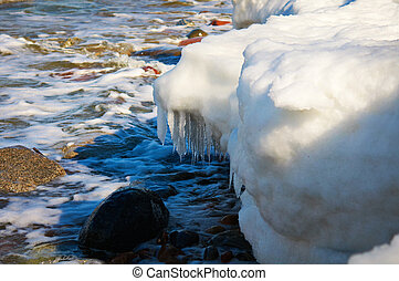 Melting of sea ice - Spring beach of Baltic sea ice-covered,...