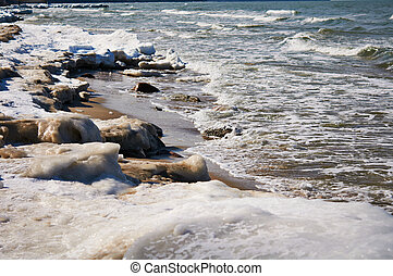 Melting of sea ice - Spring beach of Baltic sea ice-covered