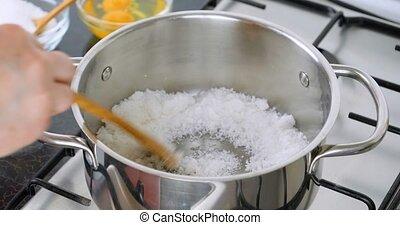 Melting sugar for caramel sauce - Cooking caramel. Chef...