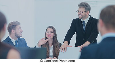 member of the business team asks a question to the speaker at a