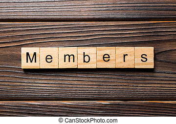 Members word written on wood block. Members text on wooden table for your desing, concept
