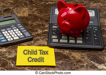 Memo stick with words Child tax credits.