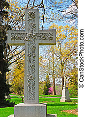 Memorial cross grave marker at historic Spring Grove Cemetery in Cincinnati Ohio USA.  Spring Grove is the second largest cemetery in the United States and was established in 1845.