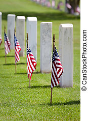 Memorial Day Cemetery - American flags on gravesites...