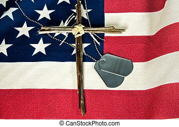 Memorial Day - Military dog tags and cross on flag.