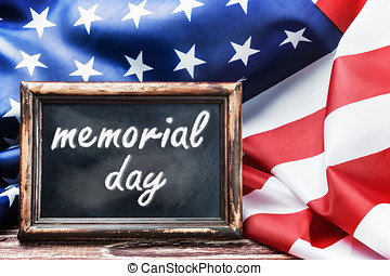 memorial day - American flag on a wooden table with the...