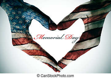 memorial day written in the blank space of a heart sign made...