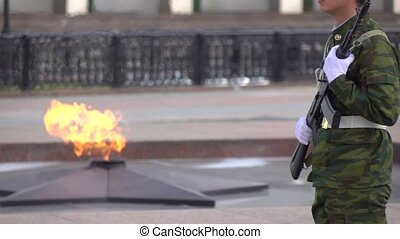 Eternal flame memorial and armed guard. Super slow motion video