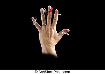 Memory Aid - Hand with strings tied to each finger to assist...